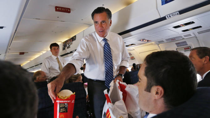Republican presidential nominee Romney hands out McDonald's french fries to the media aboard his campaign plane leaving Weyers Cave