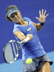 Li Na of China returns a ball during her women&#39;s singles match against Shuai Peng of China at the China Open tennis tournament in the National Tennis Centre in Beijing. Li Na won 4-6, 6-2, 7-6