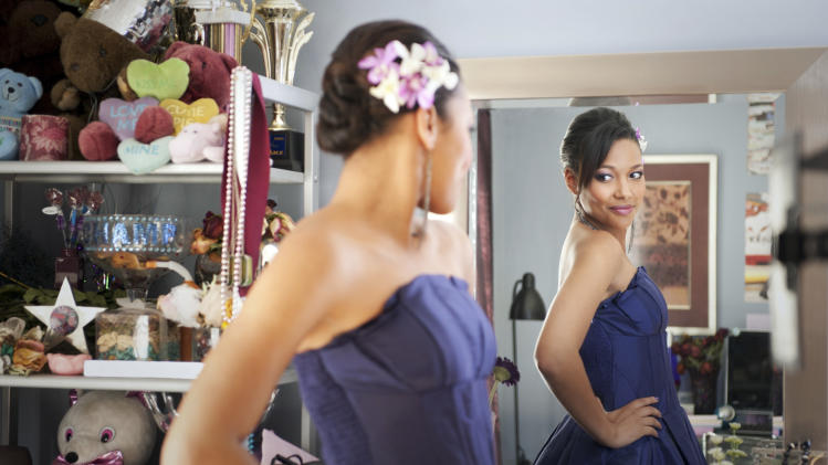 """This image courtesy of Disney Enterprises, Inc. shows Kylie Bunbury  during a scene from the Disney film """"Prom.""""  Prom-dress trends come and go _ bright colors and bohemian looks this season _ but the fashion personalities of the high-school girls celebrating the end of the school year in probably the fanciest dress they've ever worn are consistent: Every ballroom has its princess, glamour puss, trendsetter and rebel.  (AP Photo/Disney Enterprises, Inc., Richard Foreman Jr.)"""
