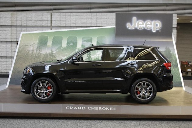 FILE - This Feb. 16, 2012 file photo shows a 2012 Jeep Grand Cherokee on display at the 2012 Pittsburgh Auto Show. A government agency is investigating safety problems with two vehicles made by Chrysler, the Ram pickup truck and Jeep Grand Cherokee SUV. The rear wheels can lock up in Rams from the 2009 and 2010 model years, potentially causing crashes, while power steering fluid hoses can leak in 2012 Grand Cherokees, possibly causing engine fires, according to documents posted Monday, July 23, 2012, on the National Highway Traffic Safety Administration website. (AP Photo/Gene J. Puskar, file)