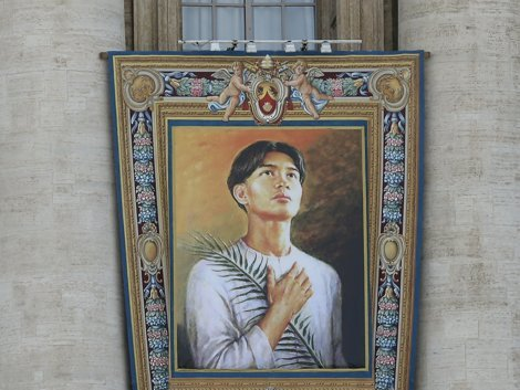 The tapestry of Pedro Calungsod, of the Philippines, hangs from the St. Peter's Basilica, at the Vatican, Friday, Oct. 19, 2012. Calungsod will be declared a saint along with six others in a ceremony (Photo by Associated Press)