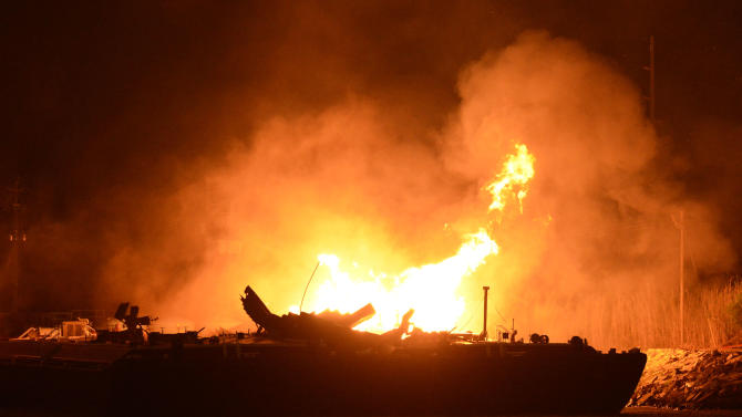 A massive explosion at 3 a.m. EDT on one of the two barges still ablaze in the Mobile River in Mobile, Ala., on Thursday, April 25, 2013. Three people were injured in the blast. Fire officials have pulled units back from fighting the fire due to the explosions and no immediate threat to lives. (AP Photo John David Mercer) Three people were hospitalized with burns. Information on their conditions was not immediately available.