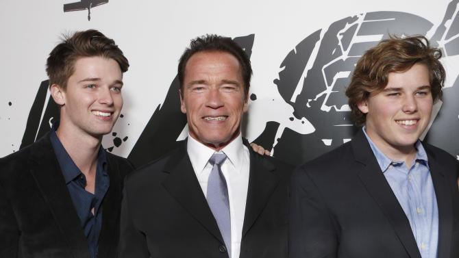 "Patrick Schwarzenegger, Arnold Schwarzenegger and Chris Schwarzenegger attend the LA premiere of ""The Last Stand"" at Grauman's Chinese Theatre on Monday, Jan. 14, 2013, in Los Angeles. (Photo by Todd Williamson/Invision/AP)"