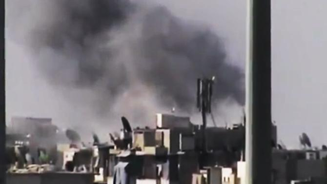 FILE - This Tuesday, July 31, 2012 file photo image made from amateur video released by the Ugarit News purports to show black smoke rising from buildings in Aleppo, Syria. Its forces stretched thin on multiple fronts, President Bashar Assad's regime has significantly increased its use of air power against Syrian rebels in recent weeks, causing mounting civilian casualties. The shift is providing useful clues about the capability of the air force as Western powers consider the option of enforcing a no-fly zone over the northern part of the country.(AP Photo/Ugarit News via AP video, File) THE ASSOCIATED PRESS IS UNABLE TO INDEPENDENTLY VERIFY THE AUTHENTICITY, CONTENT, LOCATION OR DATE OF THIS HANDOUT PHOTO