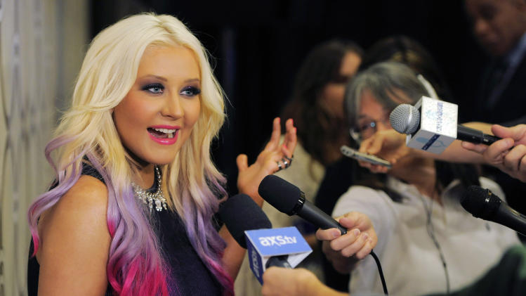 Singer Christina Aguilera is interviewed after announcing the nominations for the 2012 American Music Awards at the J.W. Marriott L.A. Live on Tuesday, Oct. 9, 2012, in Los Angeles. The 40th Anniversary American Music Awards will be held on November 18 at the Nokia Theatre in Los Angeles. (Photo by Chris Pizzello/Invision/AP)