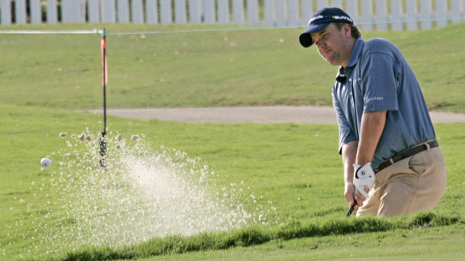 Andrade shoots 65, grabs share of Champions lead