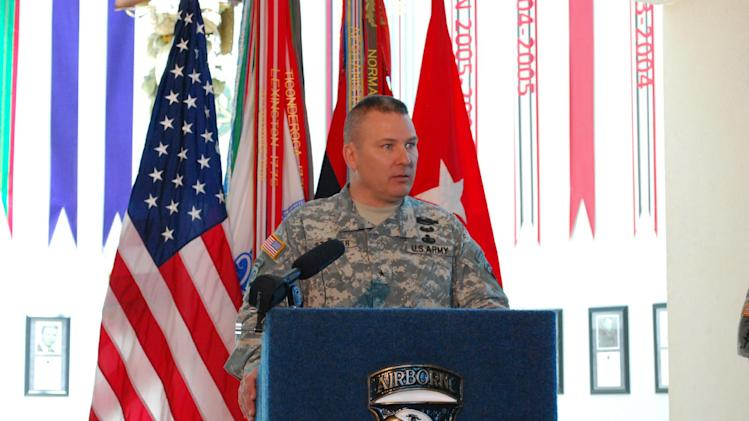 "Brig. Gen. Mark Stammer, of the 101st Airborne Division, talks on Thursday, June 27, 2013, at Fort Campbell, Ky., about the deactivation of the 4th Brigade Combat Team. The division is trying to save their storied 506th Infantry Regiment, which traces its lineage back to the ""Band of Brothers"" from World War II, from being eliminated under the Army's massive restructuring. (AP Photo/Kristin M. Hall)"