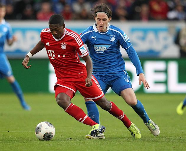 Hoffenheim's Sebastian Rudy, right, and Bayern's David Alaba of Austria challenge for the ball during a German first division Bundesliga soccer match between TSG 1899 Hoffenheim and Bayern Munich in S