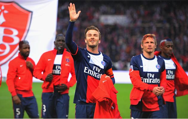 David Beckham waves to his family prior to the start of the match. (Getty)