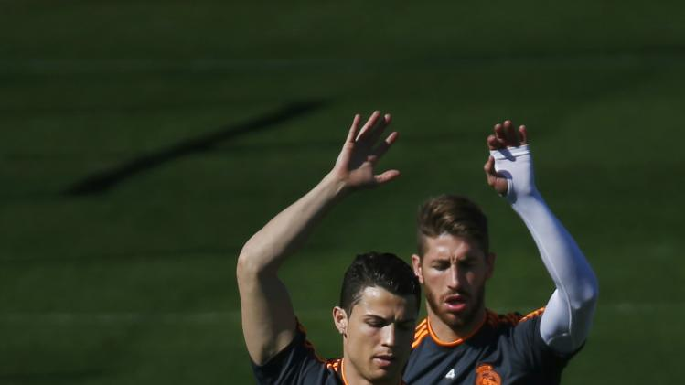 Real Madrid's Cristiano Ronaldo and Ramos attend a training session at the Valdebebas training grounds, outside Madrid