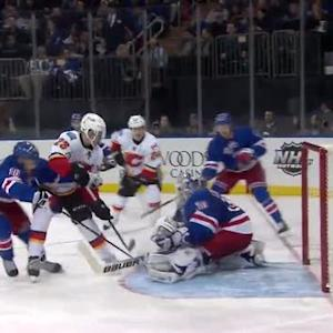 Sean Monahan chips it over Lundqvist