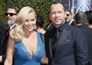 Actress Jenny McCarthy and actor Donnie Wahlberg pose at the 2014 Creative Arts Emmy Awards in Los Angeles