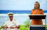 "US Secretary of State Hillary Clinton (R) speaks at an event on peace and security in Rarotonga, Cook Islands on August 31, 2012. Clinton vowed that the United States would remain committed to the South Pacific ""for the long haul"" and offered new aid"
