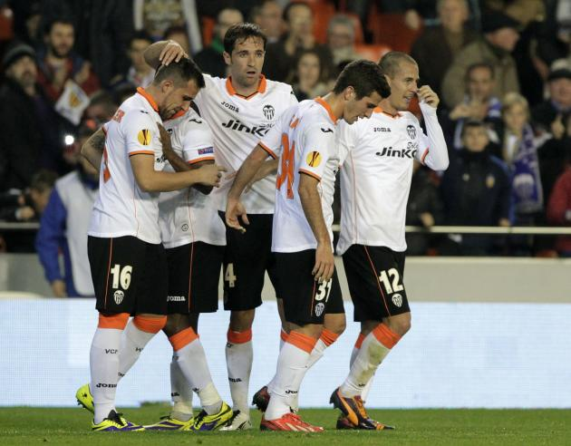 Valencia's Alcacer is congratulated by team mates after he scored against Kuban Krasnodar during their Europa league soccer match at the Mestalla stadium in Valencia