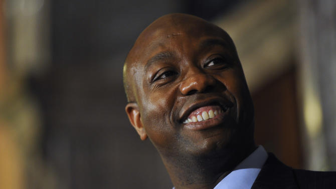 U.S. Rep. Tim Scott smiles during a press conference announcing him as Jim DeMint's replacement in the U.S. Senate at the South Carolina Statehouse on Monday, Dec. 17, 2012, in Columbia, S.C. South Carolina Gov. Nikki Haley announced Scott, as Sen. Jim DeMint's replacement, making him the only black Republican in Congress and the South's first black Republican senator since Reconstruction. (AP Photo/Rainier Ehrhardt)
