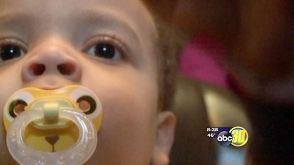 Stranger charged for slapping crying toddler in face on airplane