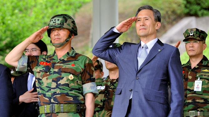 South Korean Defense Minister Kim Kwan-jin, right, and Lt. Gen. Yoo Nak-jun, left, commander of South Korean Marine Corps, salute during the establishment ceremony of the Northwest Islands Defense Command at the Marines headquarters in Hwaseong, South Korea, near the tense disputed Yellow Sea border with the North, on Wednesday, June 15, 2011. Ties between the Koreas were strained last year by two deadly attacks Seoul blames on Pyongyang. (AP Photo/Jung Yeon-je, Pool)