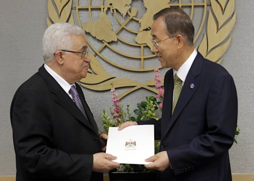 Palestinian President Mahmoud Abbas, left, gives a letter requesting recognition of Palestine as a state to Secretary-General Ban Ki-moon during the 66th session of the General Assembly at United Nations headquarters Friday, Sept. 23, 2011. (AP Photo/Seth Wenig)