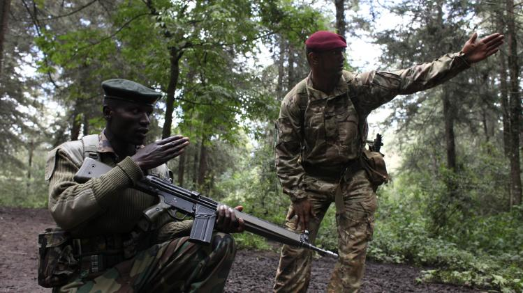 A British Army Paratrooper instructs a Kenyan ranger during a training course against poaching and logging near Nanyuki town