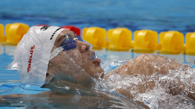 China's Xu Jiayu competes in a men's 100m backstroke heat at the Swimming World Championships in Kazan, Russia, Monday, Aug. 3, 2015. (AP Photo/Sergei Grits)