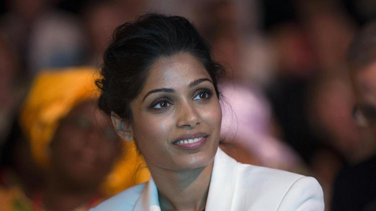"Indian actress Freida Pinto, smiles, during the Girl Summit 2014, at the Walworth Academy, in London, Tuesday, July 22, 2014. ""Slumdog Millionaire"" actress Freida Pinto has joined forces with girls' rights campaigners calling for an end to the practice of female genital mutilation. The actress, who is an ambassador for an international children's development organization, addressed a London summit Tuesday calling for more progress to abolish the practice and end child marriages. (AP Photo, PA, Oli Scarff) UNITED KINGDOM OUT"