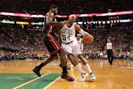 Boston Celtics' Paul Pierce (R) drives to the basket past Miami Heat's LeBron James in game four of their NBA Eastern Conference finals playoff series on June 3