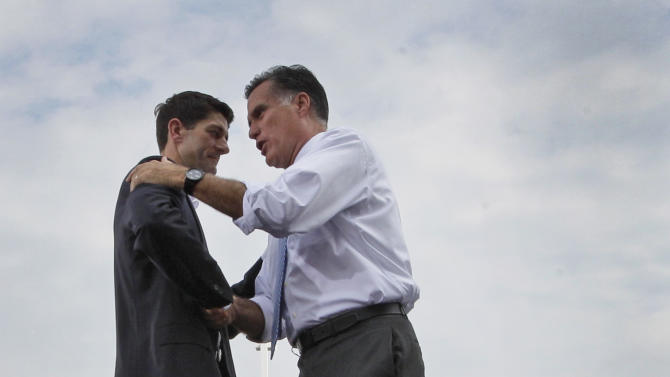 Republican presidential candidate, former Massachusetts Gov. Mitt Romney, joins his new vice presidential running mate, Wisconsin Rep. Paul Ryan, left, on stage during the Norfolk Victory campaign event, Saturday, Aug. 11, 2012, in Norfolk, Va. (AP Photo/Mary Altaffer)