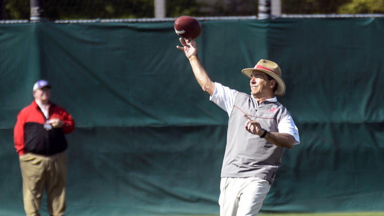 Nick Saban threw out the first pitch at the Alabama-Auburn baseball