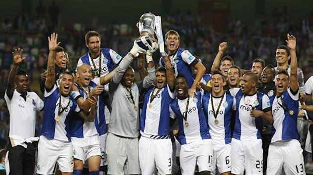 Porto's players celebrate with their trophy after defeating Academica at the Portuguese Super Cup (Reuters)