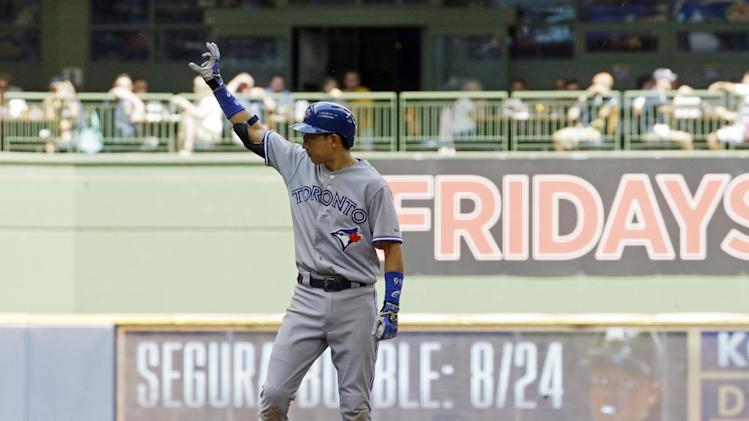 Toronto Blue Jays' Munenori Kawasaki hits an RBI double during the sixth inning of a baseball game against the Milwaukee Brewers Wednesday, Aug. 20, 2014, in Milwaukee. (AP Photo/Morry Gash)
