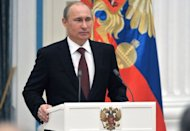 <p>Russia's President Vladimir Putin speaks during an awards ceremony at the Kremlin in Moscow, on December 26, 2012. Russia's upper house of parliament unanimously backed Wednesday a bill barring Americans from adopting Russian children, leaving the controversial measure in the hands of Putin.</p>