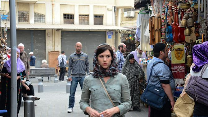 "This undated image released by Showtime shows actors Claire Danes as Carrie Mathison in a scene from the second season of ""Homeland,"" filmed in Israel. The scene from a recent episode of the hit series ""Homeland,"" is supposed to be Beirut - but it was shot in Tel Aviv, Israel. And that has some people irritated in both cities.  (AP Photo/Showtime, Ronen Akerman)"