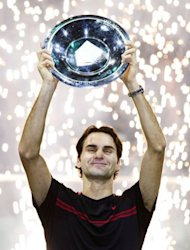 Switzerland&#39;s Roger Federer holds the trophy after winning the ABN AMRO Tennis Tournament in Rotterdam. Federer won the final 6-1, 6-4 against Juan Martin de Potro of Argentina