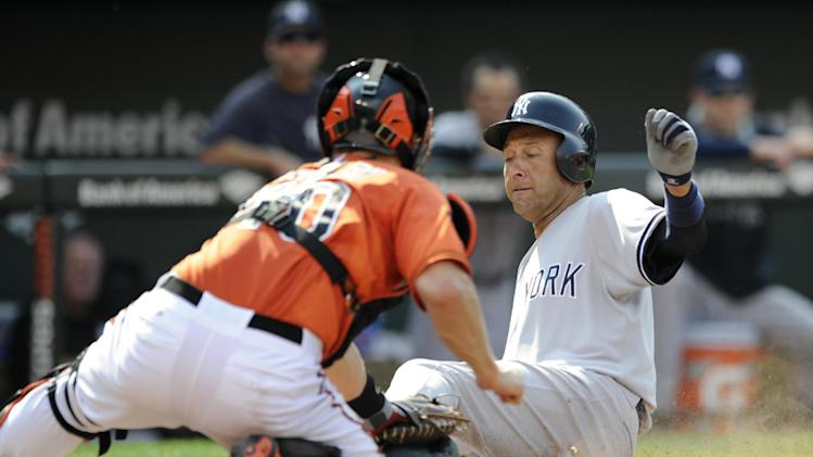 New York Yankees' Derek Jeter, right, is tagged out at home by Baltimore Orioles catcher Nick Hundley, left, during the third inning of a baseball game, Saturday, July 12, 2014, in Baltimore. (AP Photo/Nick Wass)
