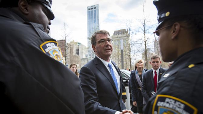U.S. Secretary of Defense Ashton Carter greets New York Police Officers after wreath at 9/11 Memorial in New York