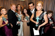 Actors Sarah Hyland, from left, Jesse Tyler Ferguson, Sofia Vergara, Ariel Winter, Ty Burrell, Julie Bowen and Nolan Gould pose backstage with the award for outstanding ensemble in a comedy series for Modern Family at the 19th Annual Screen Actors Guild Awards at the Shrine Auditorium in Los Angeles on Sunday Jan. 27, 2013. (Photo by Matt Sayles/Invision/AP)