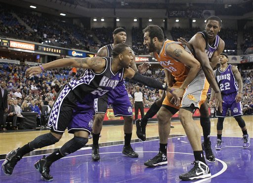 Thomas, Evans lead Kings past Suns 121-112