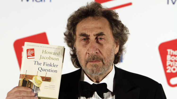 "FILE - In this Oct. 12, 2010 file photo, British author Howard Jacobson displays his book  ""The Finkler Question"", winner of  the Man Booker Prize for Fiction 2010, following the announcement at central London's Guildhall, Britain. The Dalai Lama is set to headline India's Jaipur Literature Festival to speak about faith with one of his biographers, Pico Iyer. This year's festival will also feature author Zoe Heller and Booker Prize winner Howard Jacobson. (AP Photo/Lefteris Pitarakis, File)"