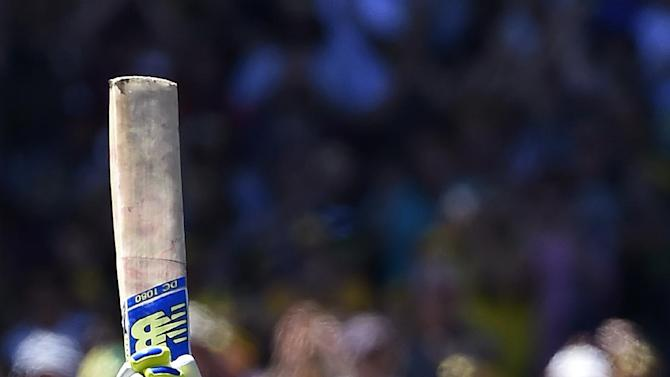 Australia's captain Steve Smith look up as he celebrates after making 100 runs against India during the second day of their cricket test match in Melbourne, Australia, Saturday, Dec. 27, 2014. (AP Photo/Andy Brownbill)