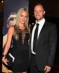 Oscar Pistorius (R) and his girlfriend Reeva Steenkamp pose for a picture in Johannesburg in this February 7, 2013 file photograph. REUTERS/Thembani Makhubele/Files
