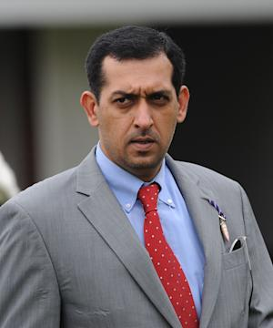 FILE - This May 18, 2012 file photo shows trainer Mahmood Al Zarooni at Newmarket, England. A leading trainer from the powerful Godolphin stable was charged Wednesday April 24, 2013 in connection with one of the biggest doping scandals to hit British horse racing. Mahmood Al Zarooni was charged with violating multiple rules related to banned substances in horses after samples from 11 of his horses at stables in Newmarket were found to contain traces of anabolic steroids. (AP Photo/PA, Anna Gowthorpe, File)