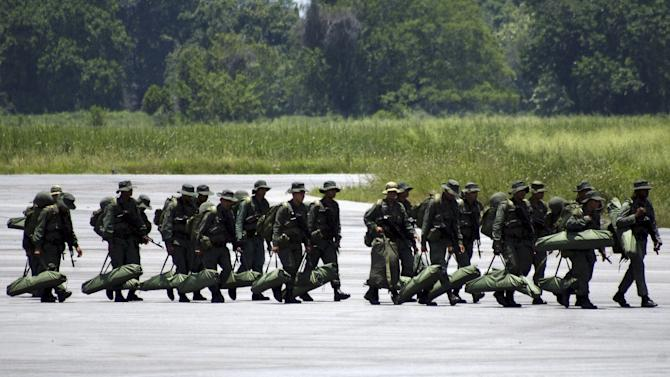Venezuelan soldiers arrive to an airport at La Fria, during a special deployment close to the border with Colombia, in Tachira state