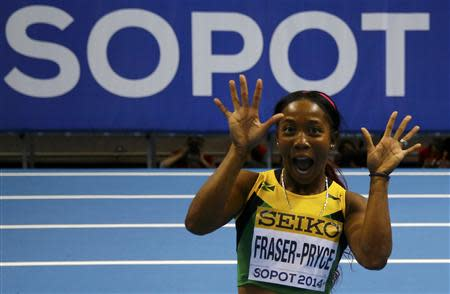 Jamaica's Fraser-Pryce celebrates after winning women's 60m final at world indoor athletics championships in Sopot