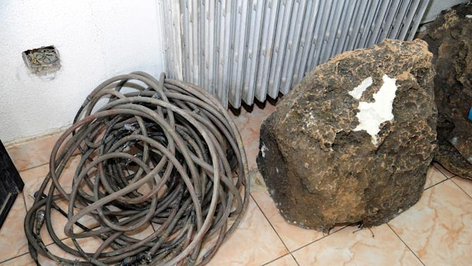 This photo released by the Syrian official news agency SANA, shows devices that appear to be like rocks that were found in country's coastal region, northwest of Damascus, Syria, Thursday, March. 7, 2013. Syria's state-run media said were placed by Israel to spy on Syria. SANA's report says the devices are designed to photograph, register and transfer data. Syria and Israel are at a state of war and fought several battles over the past. (AP Photo/SANA)