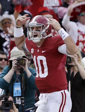 Alabama quarterback AJ McCarron (10) celebrates after a first half score against Tennessee in an NCAA college football game in Tuscaloosa, Ala., Saturday, Oct. 26, 2013. (AP Photo/Dave Martin)