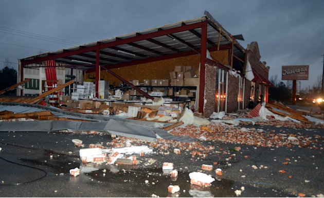 A business at 5133 Lincoln Road Extension in Hattiesburg, Miss., is damaged after an apparent tornado Sunday, Feb. 10, 2013. Major damage was reported in Hattiesburg and Petal, including on the campus