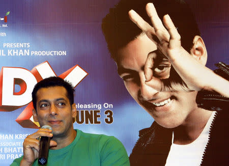 Bollywood actor Khan smiles during a promotional event for his forthcoming movie Ready in Ahmedabad