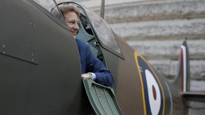 American entrepreneur and philanthropist Thomas Kaplan sits in a Mk.1 Spitfire on display outside the Churchill War Rooms in London