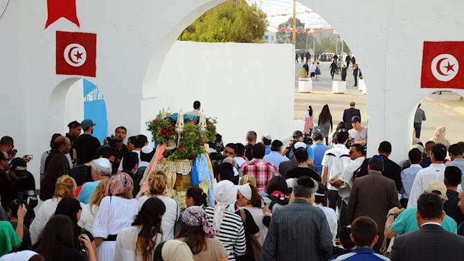 Jewish pilgrims are gathered for a procession at the Ghriba synagogue, during the annual Jewish pilgrimage in the resort of Djerba, Tunisia, Friday April 26, 2013.  They come to celebrate the annual rites at El-Ghriba, the oldest Jewish monument built in Africa more than 2,500 years ago.  On April 11, 2002 a deadly attack on the synagogue killed 21 people, including 14 German tourists.(AP Photo/Hassene Dridi)