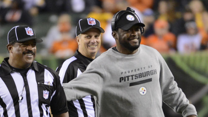 Pittsburgh Steelers head coach Mike Tomlin, center, reacts after checking a call with the officials during the second half of an NFL football game against the Cincinnati Bengals, Sunday, Oct. 21, 2012, in Cincinnati. Pittsburgh won 24-17. (AP Photo/Michael Keating)